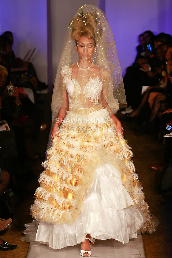 Model walks runway in an outfit from the Marlene Haute Couture Exclusive Wedding Collection, by Marlene Thomas, during Plitzs Fashion Week New York Fall 2012.