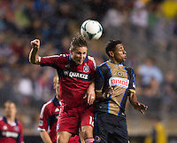 Logan Pause (12) of the Chicago Fire goes up for a header with Kleberson (19) of the Philadelphia Union during a Major League Soccer match at PPL Park in Chester, PA.  Philadelphia defeated Chicago, 1-0.