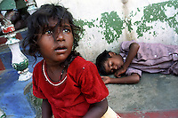 Survivors of the Tsunami - a young girl and her brother are being cared for by neighbours in Naggor Patnechari.Their parents are still missing.Nagapattinam. India.