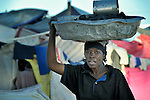 A woman sells charcoal in a camp for homeless families set up on a golf course in Port-au-Prince, Haiti, which was ravaged by a January 12 earthquake.