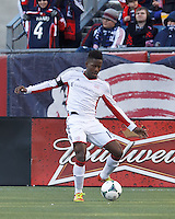 New England Revolution midfielder Clyde Simms (19) clears the ball.   In a Major League Soccer (MLS) match, Sporting Kansas City (blue) tied the New England Revolution (white), 0-0, at Gillette Stadium on March 23, 2013.