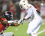 Texas' Mike Davis (1) gets past Ole Miss defensive back Charles Sawyer (3) to score at Vaught-Hemingway Stadium in Oxford, Miss. on Saturday, September 15, 2012. Texas won 66-21. Ole Miss falls to 2-1.