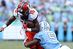 19 September 2015: Illinois' Marchie Murdock (16) is tackled by UNC's Brian Walker (5). The University of North Carolina Tar Heels hosted the University of Illinois Fighting Illini at Kenan Memorial Stadium in Chapel Hill, North Carolina in a 2015 NCAA Division I College Football game. UNC won the game 48-14.