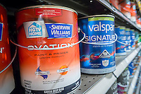 Cans of Valspar and HGTV by Sherwin-Williams brand paint are seen in a hardware store in New York on Monday, March 21, 2016. Sherwin-Williams acquired Valspar in a deal worth approximately $11.3 billion. (© Richard B. Levine)