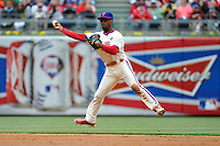 04 May 2014: Philadelphia Phillies shortstop Jimmy Rollins (11) makes a leaping throw to first during the second inning at Citizens Bank Park in Philadelphia, PA.