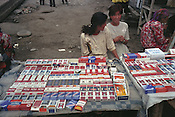 A stall selling cigarettes in the Jayma bazaar in the city of Osh. The city was once one fo the great cities of the Silk Road and of Central Asia, and is the second biggest city in the country, situated in the unstable Ferghana valley which is now becoming a hotbed if Islamic Fundamentalism. Osh, Kyrgyzstan.