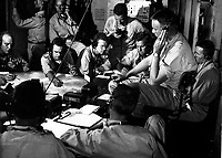 Chart room on board USS LEXINGTON as ship maneuvers into enemy waters during strike in the Gilbert and Marshall Islands.  December 1943.  Comdr. Edward J. Steichen.  (Navy)<br /> Exact Date Shot Unknown<br /> NARA FILE #:  080-G-431073<br /> WAR &amp; CONFLICT BOOK #:  969