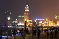 People walking along the Bund waterfront at night, 2014.<br />