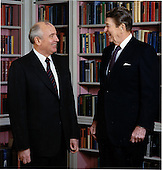 United States President Ronald Reagan and General Secretary of the Communist Party of the Soviet Union Mikhail Sergeyevich Gorbachev share a light moment during their photo session in the Library on Tuesday, December 8, 1987..Mandatory Credit: Bill Fitz-Patrick - White House via CNP