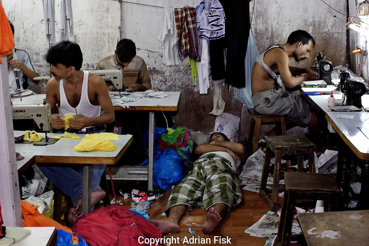 Men work on sewing machines to manufacture clothes on 21st Oct 2006.