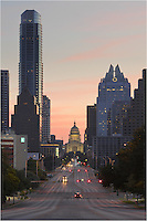 This vertical photo of the Texas State Capitol was taken on South Congress and faces north. The iconic Austonian (the tallest building in Austin, Texas) and the Frost Tower, are on either side of the capitol.