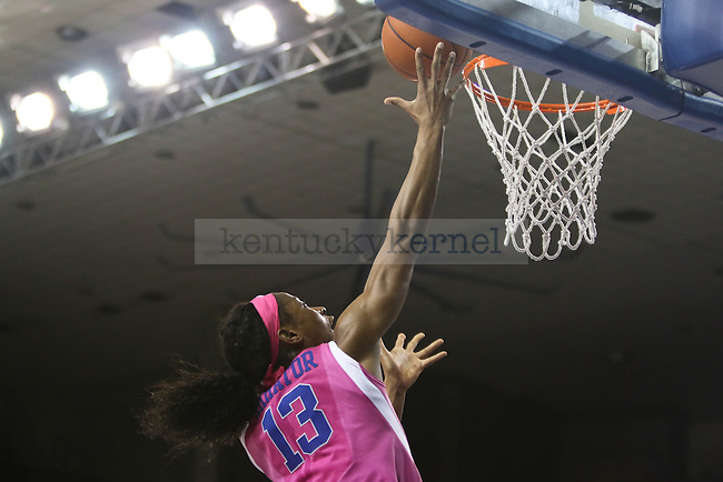 Junior forward Evelyn Akhator (13) shoots a layup during the game against the Arkansas Razorbacks on Sunday, February 21, 2016 in Lexington, Ky. Kentucky won the game 77-63. Photo by Hunter Mitchell | Staff