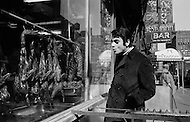 Manhattan, New York City, USA. February 16th, 1968. French singer Enrico Macias looks through the window of a restaurant in New York's Chinatown before his first concert in the U.S.