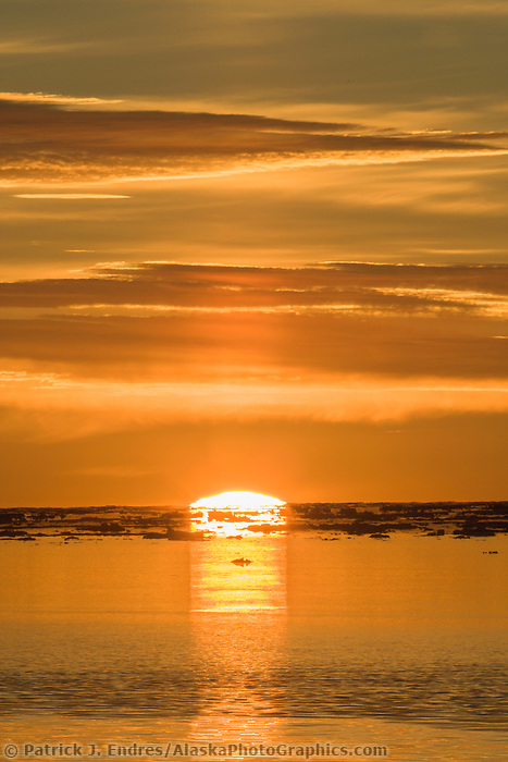 Sunset over the Beaufort Sea, with drifting pack ice, autumn sunset from Barter Island and the Inupiat village of Kaktovik in Alaska's high Arctic.
