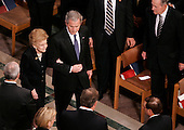 Washington, D.C. - January 2, 2007 -- United States President George W Bush escorts Betty Ford to her seat prior to funeral services for former U.S. President Gerald R. Ford at the National Cathedral in Washington, DC on Tuesday, January 2, 2007. <br /> Credit: Shawn Thew - Pool via CNP