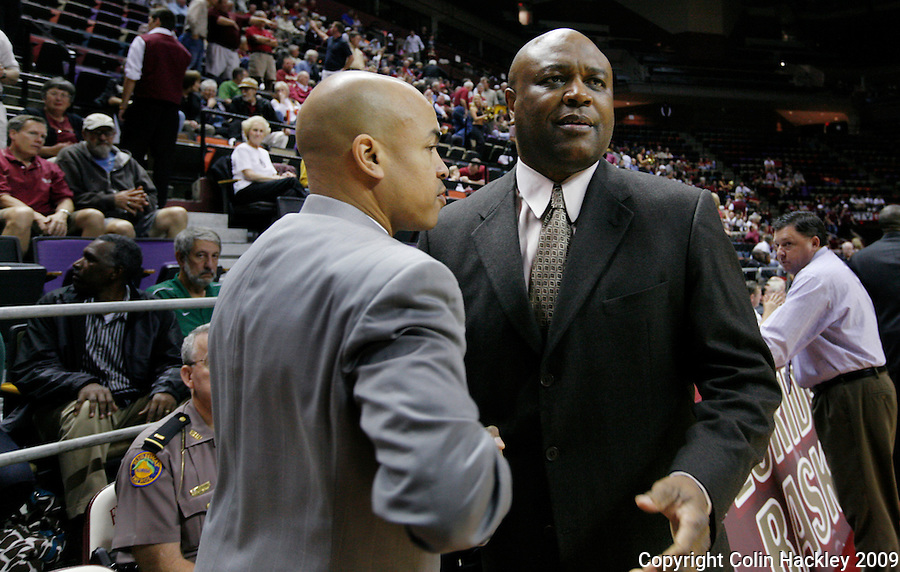TALLAHASSEE, FL 11/16/09-FSU-JU BB09 CH20-Florida State Head Coach Leonard Hamilton, right, greets Jacksonville University Head Coach Cliff Warren prior to the  game Monday at the Donald L. Tucker Center in Tallahassee. The Seminoles beat the Dolphins 87-61...COLIN HACKLEY PHOTO