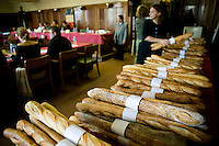 """Baguettes competing for the title of Best Baguette in Paris are lined up before the jury (L) gathers in Paris, France, 5 January 2004. 120 bakers competed in the 2004 edition of the prestigious annual Grand Prix de la Baguette. The title went to Pierre Thilloux from """"La Fournée d?Augustine"""" bakery in the 14th arrondissement of Paris."""
