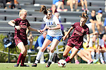 29 September 2013: Duke's Kelly Cobb (center) is defended by Virginia Tech's Kelsey Loupee (left) and Jodie Zelenky (6). The Duke University Blue Devils hosted the Virginia Tech University Hokies at Koskinen Stadium in Durham, NC in a 2013 NCAA Division I Women's Soccer match. The game ended in a 1-1 tie after two overtimes.