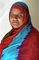 Halima Hussein at her home in the village of Al Quitey in Yafa. Although her late husband joined the British Army and then travelled the world as a sailor for the British Merchant Navy, she has never left Yemen. For centuries men have been leaving the poor, rural and very mountainous area of Yafa to seek work elsewhere.