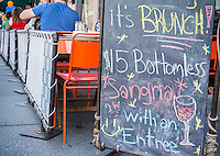 All you can drink brunch at a sidewalk cafe in the New York neighborhood of Greenwich Village on Sunday, August 2, 2015. (© Richard B. Levine)