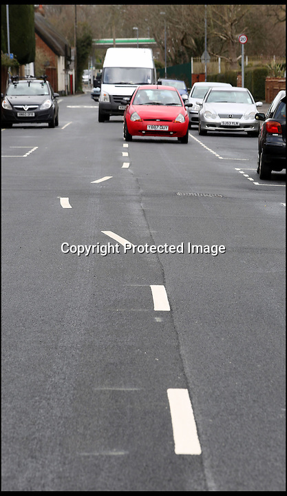 BNPS.co.uk (01202 558833)<br /> Pic: CorinMesser/BNPS<br /> <br /> ***Please use full byline***<br /> <br /> At first glance it would appear the worker who painted these wonky white lines might have had one too many in the pub.<br /> <br /> Rather than the normal straight white lines running down the centre of the road, drivers are facing weird winding markings that wiggle down the carriageway.<br /> <br /> They have been baffling motorists since they appeared on a street in Wimborne, Dorset.<br /> <br /> But road chiefs insist they are deliberate, forming part of a bizarre calming measure aimed at slowing down traffic in a notorious rat run by forcing drivers to follow a curving course.