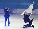November 20 2011 - Guadalajara, Mexico:  Ontario's Lieutenant Governor Honorable David Onley receives the Americas Paralympic Committee flag as Minister of Sport Bal Gossal looks on during Closing Ceremonies for the 2011 Parapan American Games at the Telmex Athletics Stadium in Guadalajara, Mexico.  Photos: Matthew Murnaghan/Canadian Paralympic Committee