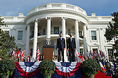 United States President Barack Obama (R) and Canadian Prime Justin Trudeau stand for their national anthems during an arrival ceremony on the South Lawn of the White House, in  Washington, D.C. on March 10, 2016. <br /> Credit: Kevin Dietsch / Pool via CNP