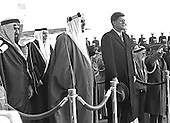 King Saud bin Abdulaziz Al Saud of Saudi Arabia makes remarks as he is welcomed to the United States by US President John F. Kennedy during a ceremony at Andrews Air Force Base, Maryland on February 13, 1962.  From left to right: unidentified, President Kennedy, King Saud, US Secretary of State Dean Rusk, unidentified, and unidentified.<br /> Credit: Arnie Sachs / CNP