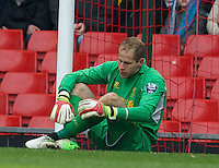 LIVERPOOL, ENGLAND - Easter Monday, April 1, 2013: Liverpool's goalkeeper Peter Gulacsi looks dejected as Tottenham Hotspur score the opening goal during the Under 21 FA Premier League match at Anfield. (Pic by David Rawcliffe/Propaganda)