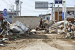 Photo shows a home and car swept inland by the tsunami that followed the March 11 magnitude 8.8 quake in Iwaki City, Fukushima, Japan on 13 March, 2011. Some 1,500 people are reported dead and tens of thousands missing after the mega-temblor. Photographer: Robert Gilhooly