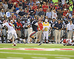 Ole Miss quarterback Jeremiah Masoli (8) runs past Fresno State's Desia Dunn (24) on a long run at Vaught-Hemingway Stadium in Oxford, Miss. on Saturday, September 25, 2010. Ole Miss won 55-38 over Fresno State.