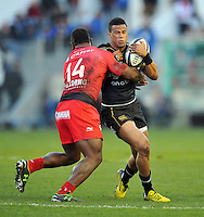Anthony Watson of Bath Rugby is tackled by Josua Tuisova of Toulon. European Rugby Champions Cup match, between RC Toulon and Bath Rugby on January 10, 2016 at the Stade Mayol in Toulon, France. Photo by: Patrick Khachfe / Onside Images