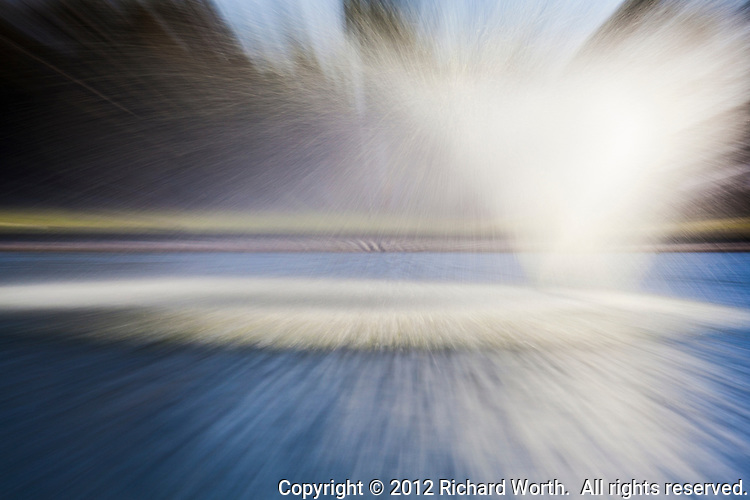Using the camera to paint with water and light.  The duck pond fountain at San Lorenzo Park captured as an abstract.