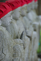 A line of Buddhist Jizo statues at a temple in Narai-juku, Kiso Valley, Nagano, Japan.