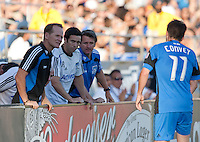 Head Coach Frank Yallop (right) and staff check in with Bobby Convey (11) from the sideline. The San Jose Earthquakes tied DC United 1-1 at Buck Shaw Stadium in Santa Clara, California on July 3rd, 2010.