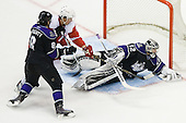 Jonathan Quick (Los Angeles Kings, #32) covers a puck during ice-hockey match between Los Angeles Kings and Detroit Red Wings in NHL league, February 28, 2011 at Staples Center, Los Angeles, USA. (Photo By Matic Klansek Velej / Sportida.com)