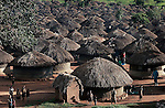 UMYAMA, UGANDA MAY 28: Children play outside huts in a camp for displaced people on May 28, 2005 in Umyama, northern Uganda. About 1.5 million people have fled villages and live in about 180 squalid Internally Displaced People (IDP) camps, which has changed the rural life in Northern Uganda. Many children in this area are afraid of being abducted by the Lord's Resistance Army (LRA). The rebel group has brought terror to Northern Uganda for almost twenty years, fighting the Ugandan government. The victims are usually children, who are abducted and used as child soldiers and sex slaves. ...