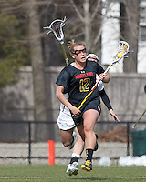 University of Maryland midfielder Erin Collins (12) brings the ball forward. .University of Maryland (black) defeated Boston College (white), 13-5, on the Newton Campus Lacrosse Field at Boston College, on March 16, 2013.