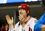 ST CHARLES, MO - MARCH 19:  a Wisconsin Badgers fan cheers his team on during the Division I Women's Ice Hockey Championship held at The Family Arena on March 19, 2017 in St Charles, Missouri. Clarkson defeated Wisconsin 3-0 to win the national championship. (Photo by Mark Buckner/NCAA Photos via Getty Images)