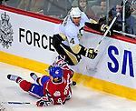 3 February 2009: Pittsburgh Penguins' defenseman Rob Scuderi gets over a fallen Montreal Canadiens right wing forward Tom Kostopoulos at the Bell Centre in Montreal, Quebec, Canada. The Canadiens defeated the Penguins 4-2. ***** Editorial Sales Only ***** Mandatory Photo Credit: Ed Wolfstein Photo