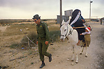 Rafah Israel 1982. Bedouin woman with child and Israeli soldier at the new crossing she is being led through.