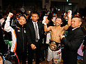 (L-R)  Hideyuki Ohashi, Takashi Uchiyama, Akira Yaegashi (JPN), Katsushige Kawashima, OCTOBER 24, 2011 - Boxing : Akira Yaegashi of Japan celebrates with Ohashi boxing gym chairman Hideyuki Ohashi, Takashi Uchiyama and Katsushige Kawashima after winning the WBA minimumweight title bout at Korakuen Hall in Tokyo, Japan. (Photo by Mikio Nakai/AFLO)