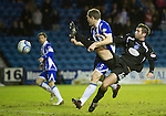 Kilmarnock v St Johnstone....15.01.11  .Peter MacDonald battles with Frazer Wright.Picture by Graeme Hart..Copyright Perthshire Picture Agency.Tel: 01738 623350  Mobile: 07990 594431