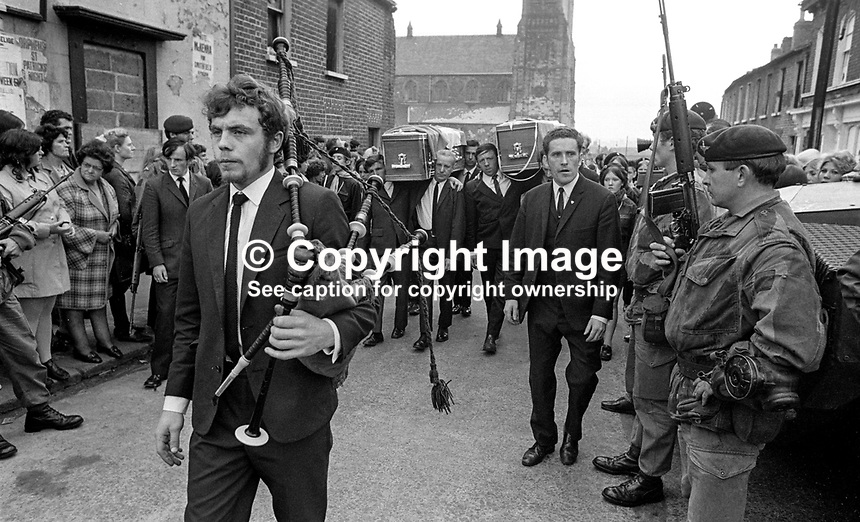 Piper heads the funeral cortege of Gerard O'Hare, 17 years, Roman Catholic, Belfast, and Rose Curry, 18 years, Roman Catholic, Lower Abercorn Street, Belfast, who died when a bomb exploded prematurely in a house in Merrion Street, Lower Falls, Belfast, on 23rd September 1971. They were members of the Official IRA. British soldiers look on impassively. 197109230354a.<br /> <br /> Copyright Image from Victor Patterson, 54 Dorchester Park, <br /> Belfast, UK, BT9 6RJ<br /> <br /> t1: +44 28 9066 1296  (from Rep of Ireland 048 9066 1296)<br /> t2: +44 28 9002 2446  (from Rep of Ireland 048 9002 2446)<br /> m: +44 7802 353836<br /> <br /> e1: victorpatterson@me.com<br /> e2: victorpatterson@gmail.com<br /> <br /> www.victorpatterson.com<br /> <br /> IMPORTANT: Please see my Terms and Conditions of Use at <br /> www.victorpatterson.com<br /> <br /> It is IMPORTANT that you familiarise yourself with them. <br /> They are available on my website.<br /> <br /> Images used on the Internet must be visibly watermarked i.e. &copy;victorpatterson.com within the body of the image and <br /> copyright metadata must not be deleted. Images used on the <br /> Internet have a size restriction of 4kbs and are chargeable at <br /> the then current NUJ rates.