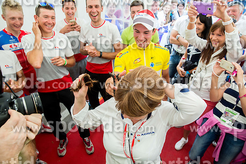 ROGLIC Primoz (Slovenia) of Adria Mobil, overall winner in yellow jersey cut hair of Mojca Novak, president of KK Adria Mobil  as she has promised if Roglic win the race after the Stage 4 of 22nd Tour of Slovenia 2015 from Rogaska Slatina to Novo mesto (165,5 km) cycling race  on June 21, 2015 in Slovenia. Photo by Vid Ponikvar / Sportida