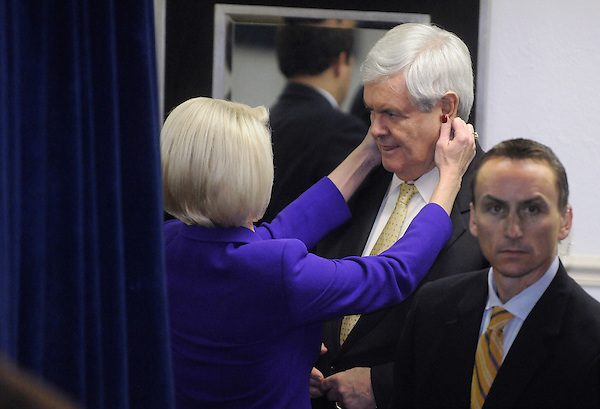Florence, South Carolina: January 17, 2012<br /> <br /> Callista Gingrich double checks the appearance of her husband, presidential candidate Newt Gingrich, moments before they entered a room for a town hall meeting. The man standing beside them is a member of their security detail. It happened inside the Art Trail Gallery, four days before the South Carolina presidential primary election. &copy;Chris Fitzgerald / CandidatePhotos