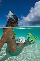 Split level view of a snorkeler<br /> Hawksnest Beach<br /> Virgin Islands National Park<br /> St. John, U.S. Virgin Islands