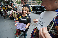 Members of the Granny Peace Brigade and their supporters protest in front of the Ecuadorian Consulates offices in New York on Thursday, September 27, 2012 to support Wikileaks founder Julian Assange who is living in Ecuador's London embassy for 100 days. Assange faces questioning in Sweden over sex assault claims and has been granted asylum in the South American country's embassy in the UK. (© Richard B. Levine)