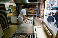 Anis Bouabsa, winner of the Best Baguette in Paris prize for 2008, prepares bread in his bakery, Au Duc de la Chapelle in the 18th arrondissement of Paris, France, 21 January 2008.