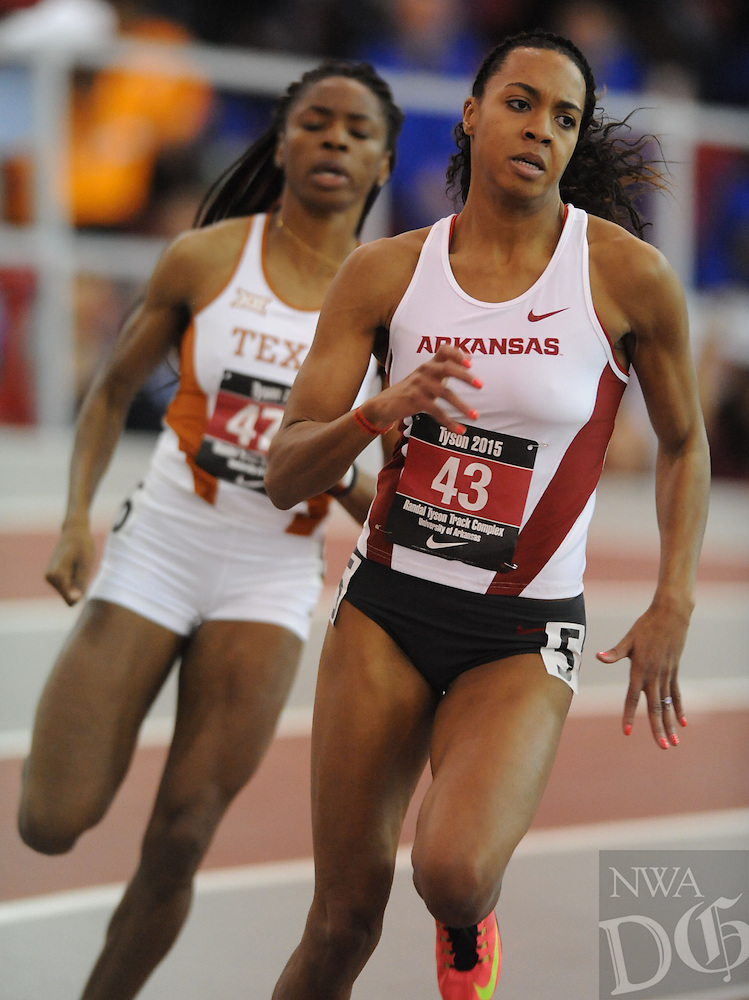 NWA Democrat-Gazette/ANDY SHUPE - Taylor Ellis-Watson of Arkansas (43) leads Courtney Okolo of Texas in the final turn while competing in the 400 meters during the Tyson Invitational Friday, Feb. 13, 2015, at the Randal Tyson Track Center in Fayetteville.